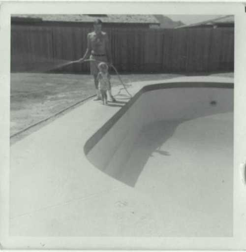 Me and Dad (and the hose) by the pool circa 1970